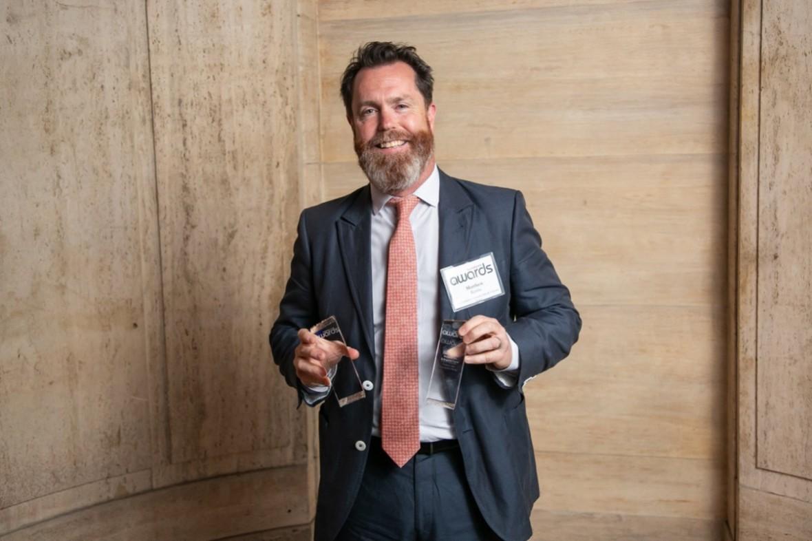 CEO Matt Rembe holding award