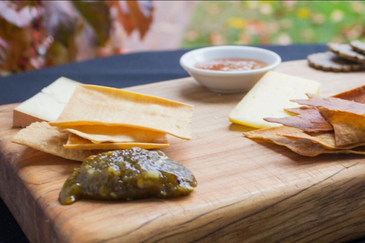cracker and cheese spread featuring green chili jam